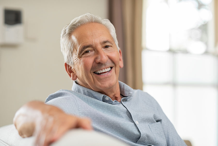 Pros and Cons of Dentures vs Dental Implants